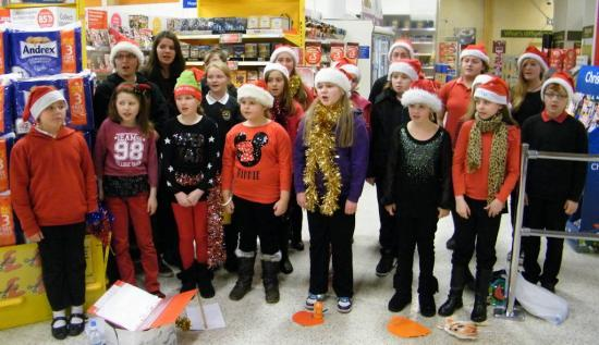 Photograph of Caithness And North Sutherland Children's Choir Sing Christmas songs At Tesco, Wick