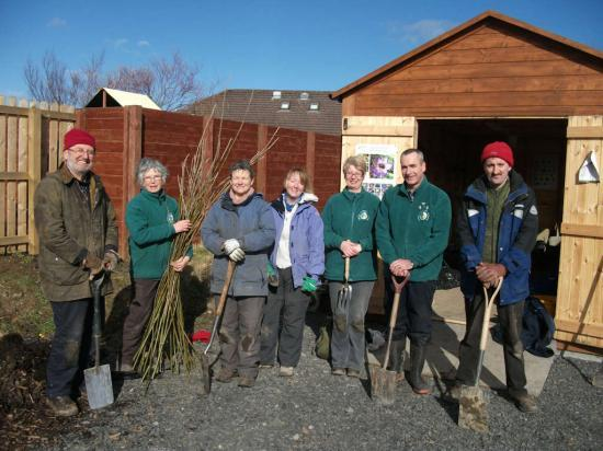 Photograph of Volunteers get to work planting for the future