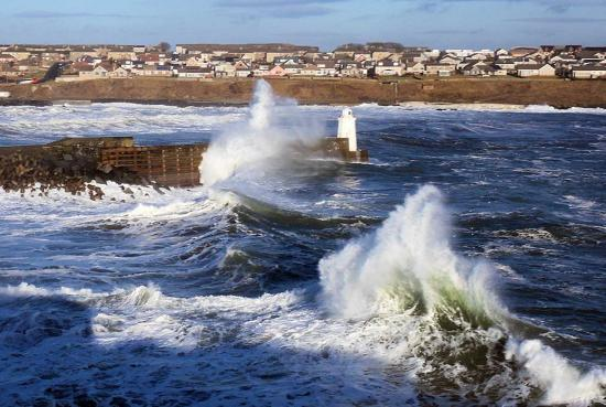 Photograph of Waves Still Crash Into Piers At Wick Harbour 20th January 2014