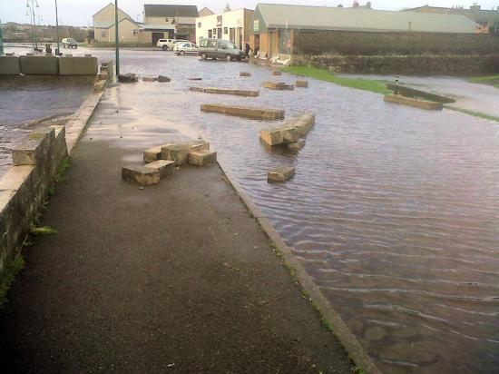 Photograph of Tidal wave causes damage to Thurso riverside wall