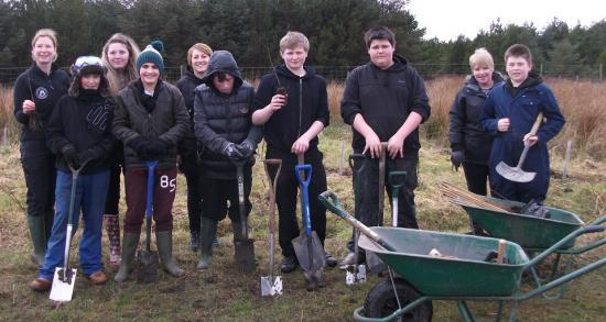Photograph of Wick High School pupils get planting