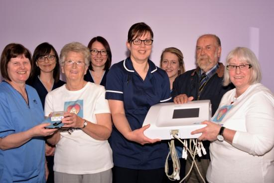 Photograph of Caithness Heart Support Group handed over equipment to Wick GP surgeries